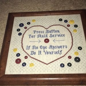 Cross-stitched art- press button for maid service